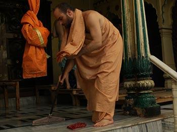 Cleaning Radha Damodar Devotees Altar