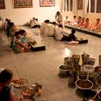 Devotees taking prasadam