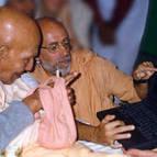 Srila Puri Maharaja looking at website made by Swami B.B. Vishnu