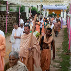Devotees Proceed to the New Temple
