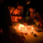 Children Lighting Candles