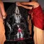 Srila Guru Maharaja Begins Bathing the Deity