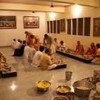 Devotees Honouring Prasadam