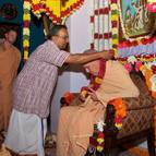 Caitanya Dasa Offers a Garland to Guru Maharaja