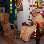 Guru Maharaja Reading the Vyasa-Puja Book