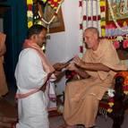 Guru Maharaja Presents Madhumangala with a Shawl and Picture