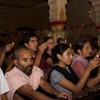 Devotees Offering Lamps to Damodara