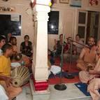 Guru Maharaja Leading Bhajanas on Prabhupada's Verandah