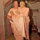 Guru Maharaja Carrying Srila Prabhupada to the Verandah