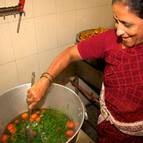 Prema-manjari Mataji Cooking Sambhar for the Offering