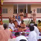 Rupanuga Prabhu Reaing His Offering to Guru Maharaja