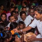 Kunja-vihari Distributing Candana Prasada