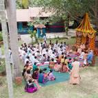 Devotees Sit to Hear Hari-katha from Guru Maharaja