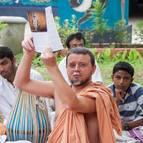 Giri Maharaja Showing the Devotees the Book