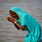 Woman Offering Respects to Mother Ganga
