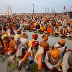 Sadhus Sit Down for a Free Meal