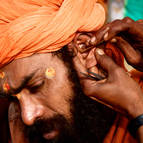 A Hindu Holy Man Gets His Ears Cleaned