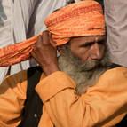 Sadhu Putting on a Turban
