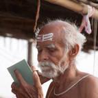 An Old Brahmana Applying Tripundram