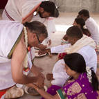 Devotees Tie 'Kautukas' on the Participants Wrists