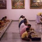 Devotees and Guests Honour Prasada