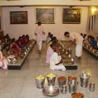 Devotees Honouring the Lord's Prasadam