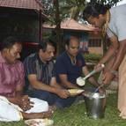 Rasikananda Prabhu Serving Prasadam to Guests and Devotees