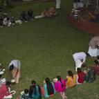 Everyone Sits down preparing for Prasadam