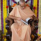 Guru Maharaja Reading Through the Book
