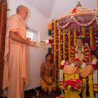 Srila Guru Maharaja Offering Arati to Prabhupada