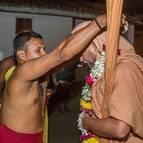 A Pujari Offers a Garland to Maharaja
