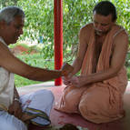 Giri Maharaja tying a kautuka on Balarama before the homa
