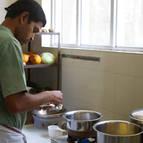 Syamasundara preparing puspanna rice