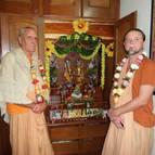 Srila Guru Maharaja and Giri Maharaja in front of the altar.