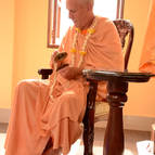 Guru Maharaja playing karatalas