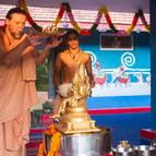 Giir Maharaja performing arati of Laksmi-Narasimha