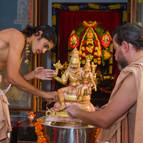Cleaning ghee off the Deities