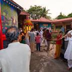Murali-Krsna Dasa playing flute during rathotsava