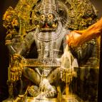 The beginning of Lord Narasimha's main abhiseka at twilight