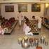 Devotees Honouring the Lord's Prasadam