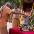 Guru Maharaja bathes Giriraja